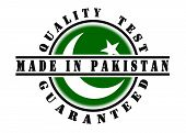 stock photo of pakistani flag  - Quality test guaranteed stamp with a national flag inside Pakistan - JPG
