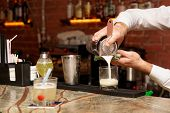 picture of bartender  - Bartender is making cocktail at bar counter  - JPG