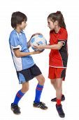 Two Children Soccer Players Fighting For A Ball