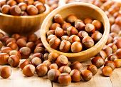 stock photo of hazelnut  - a fresh hazelnuts on a wooden table - JPG