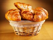 picture of croissant  - a fresh croissants on a wooden table - JPG