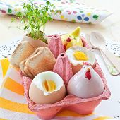 foto of salt shaker  - Boiled eggs with toasted bread and cute salt and pepper shakers - JPG
