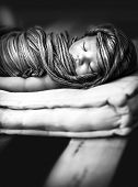 Closeup black and white photo of cute sleeping baby wrapping in stylish scarf, peaceful nap, innocen