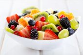 foto of vegetarian meal  - bowl of fruit salad on wooden table - JPG