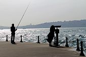 Fisherman And Tourist Silhouette Bosphorus Istanbul