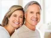 picture of elderly couple  - Happy smiling elderly couple at new home - JPG