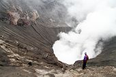 picture of bromo  - Man standing inside crater of volcano Bromo in Indonesia - JPG