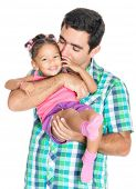 Father carrying and kissing his funny small multiracial daughter isolated on white