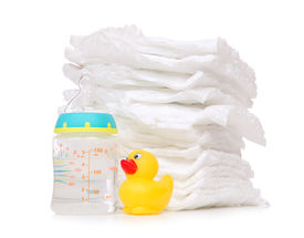 picture of nipples  - New born child stack of diapers nipple soother baby feeding milk bottle with water and yellow duck on a white background - JPG