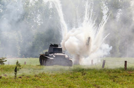 stock photo of panzer  - WW2 German Panzer 38 (t) light tank and the explosion of a shell hit ** Note: Visible grain at 100%, best at smaller sizes - JPG
