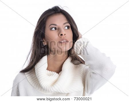 Beautiful young woman - face isolated on white background looking away in a white wool pullover for winter.
