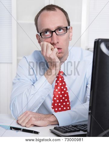 Frustrated business man with tie and glasses at Office.