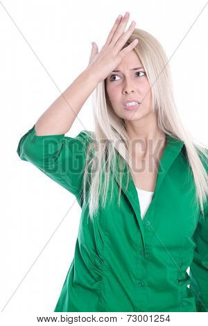 Business pressure: frustrated pretty young woman in green blouse is touching her head isolated on white background
