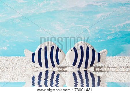 Love couple - two blue fish at sea. Nautical decoration.