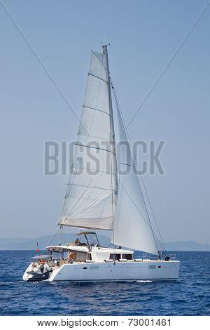 Sailing - Catamaran at full speed - Blue Cruise