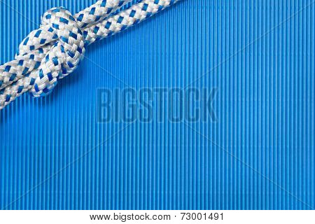 Maritime background in blue with knot
