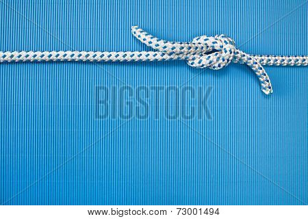 Rigging - sailor knots - blue background maritime