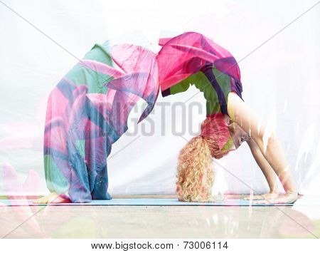 Double exposure portrait of young woman performing back bend combined with photograph of nature