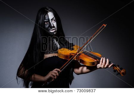 Scary monster playing violing in halloween concept