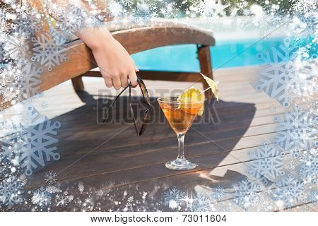 Tropical juice by swimming pool against snow