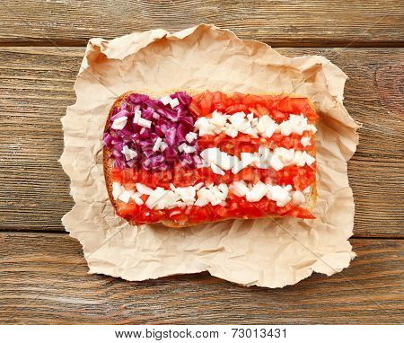 Sandwich with flag of USA on table close-up