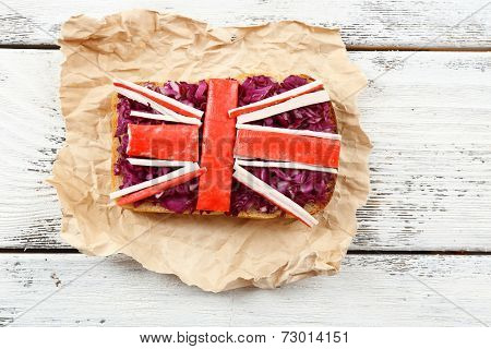 Sandwich with flag of Great Britain on table close-up