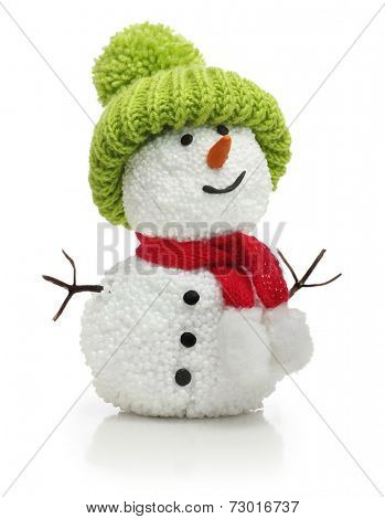 Snowman in green hat and red scarf isolated on white background.