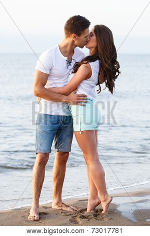 Summer, sea. Cute, lovely couple on the beach