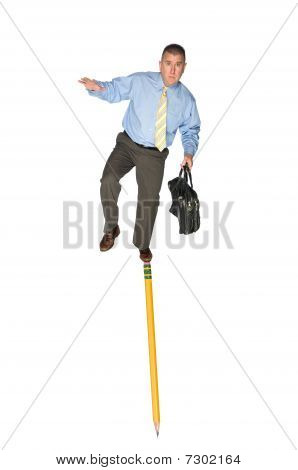 Businessman Balancing On Pencil