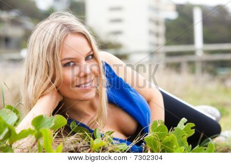 Woman Reclining In The Grass