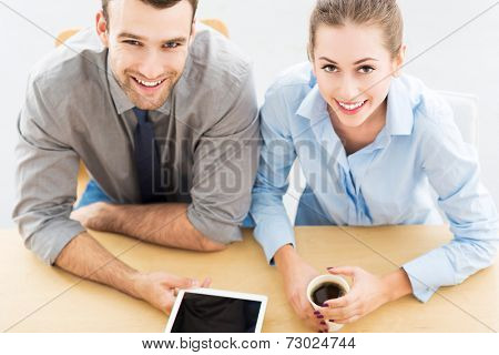 Business people with digital tablet and coffee