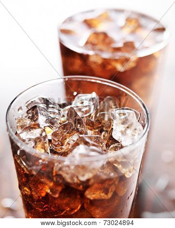 glass cup of cola soda with ice