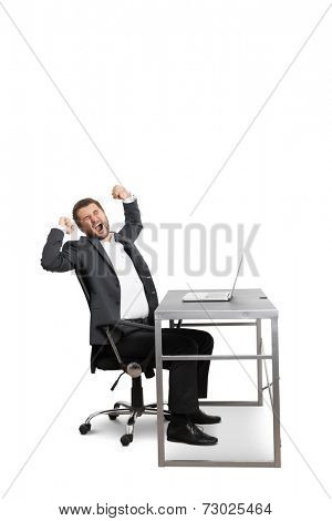 fatigued businessman yawning and stretching oneself. isolated on white background