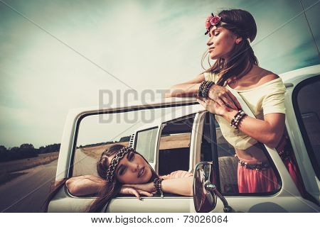 Hippie girls in a minivan on a road trip