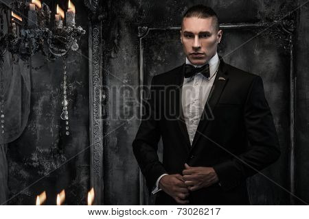 Young man wearing tuxedo in classical interior