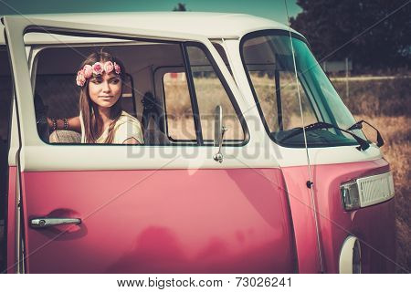Hippie girl in a minivan on a road trip
