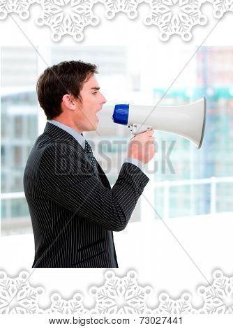 Frustrated businessman yelling through a megaphone against snowflake frame