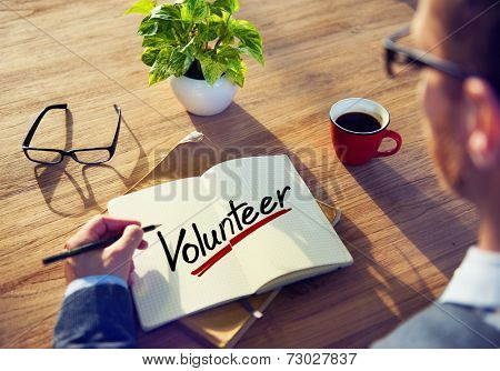 Man with a Note and a Single Word Volunteer