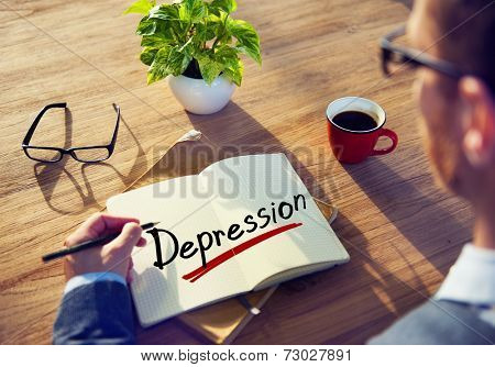 Businessman Writing the Word Depression