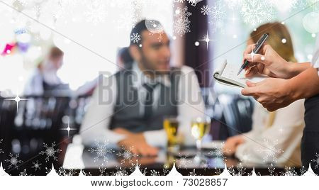 Composite image of a Waitress writing an order against snow
