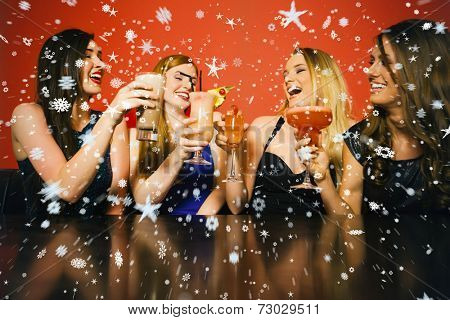 Composite image of Happy friends clinking glasses against snow