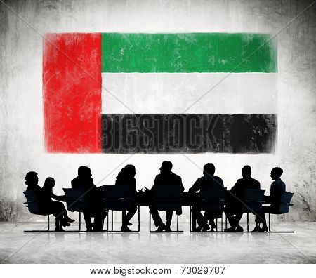 Business People in a Meeting with United Arab Emirates Flag