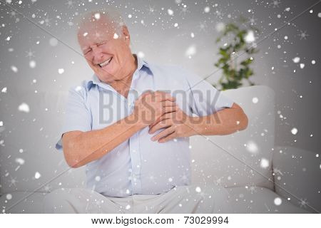 Composite image of old man suffering with heart pain against snow falling