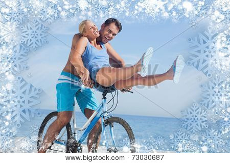 Happy man giving girlfriend a lift on his crossbar against snow