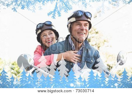 Happy senior couple riding a moped against snow