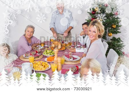 Happy family at christmas dinner against fir tree forest and snowflakes