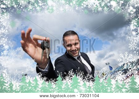 Composite image of happy seller holding car keys against snow