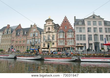 Ghent, Belgium - September 5, 2014: View of historical center of Gent with picturesque medieval gabled houses along canal. Ghent is a city and a municipality located in the Flemish region of Belgium.