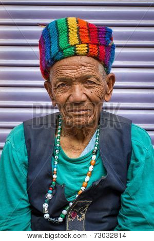 KATHMANDU, NEPAL - APRIL 2 - Portrait of an unidentified man with nice rainbow hat on APRIL 2, 2014, Nepal.