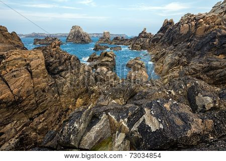 Sharp rocky coastline in the Ushant island (aka Ouessant), Brittany, France